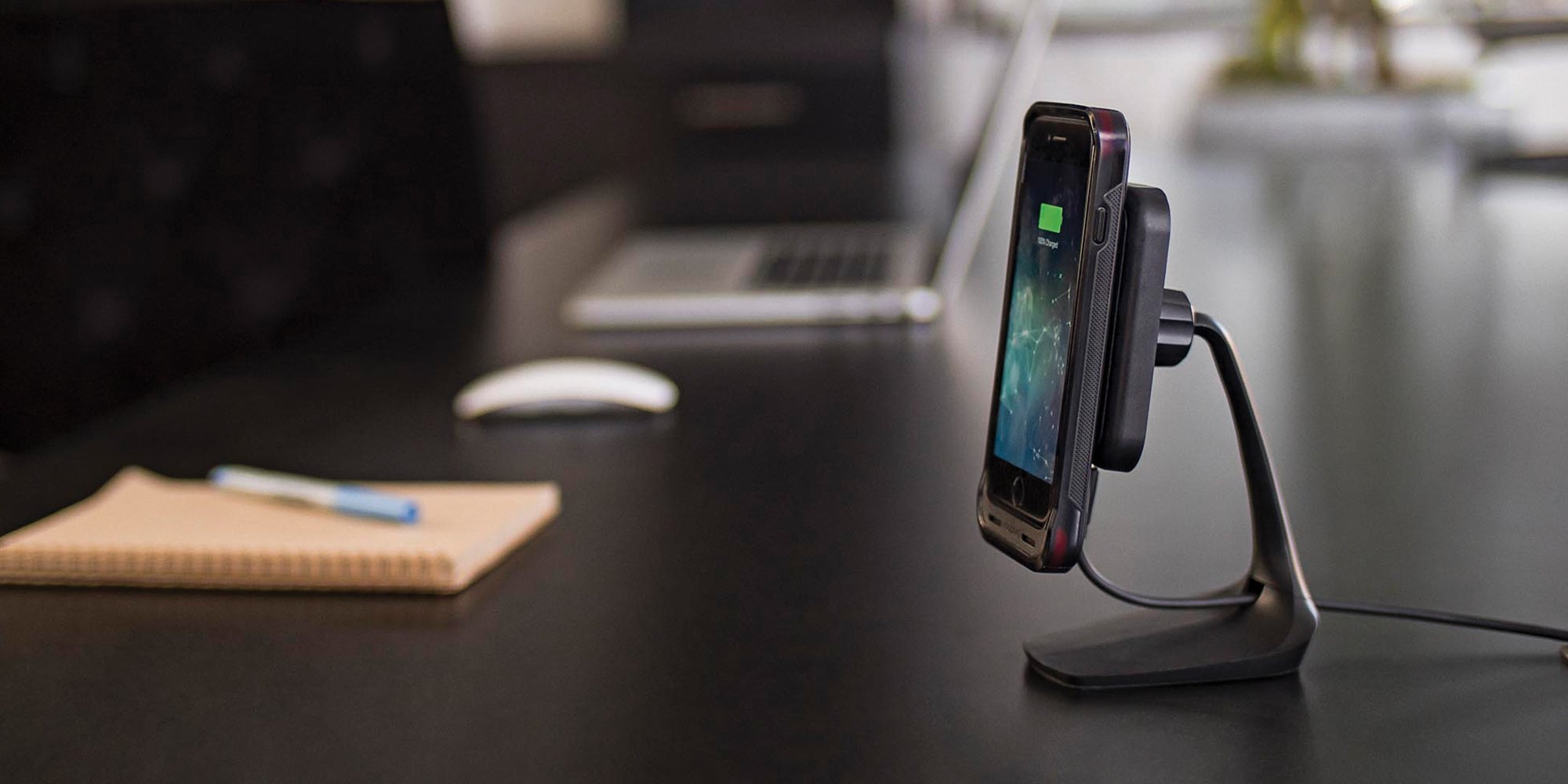 phone with a juice pack flex on it on a mophie desk stand