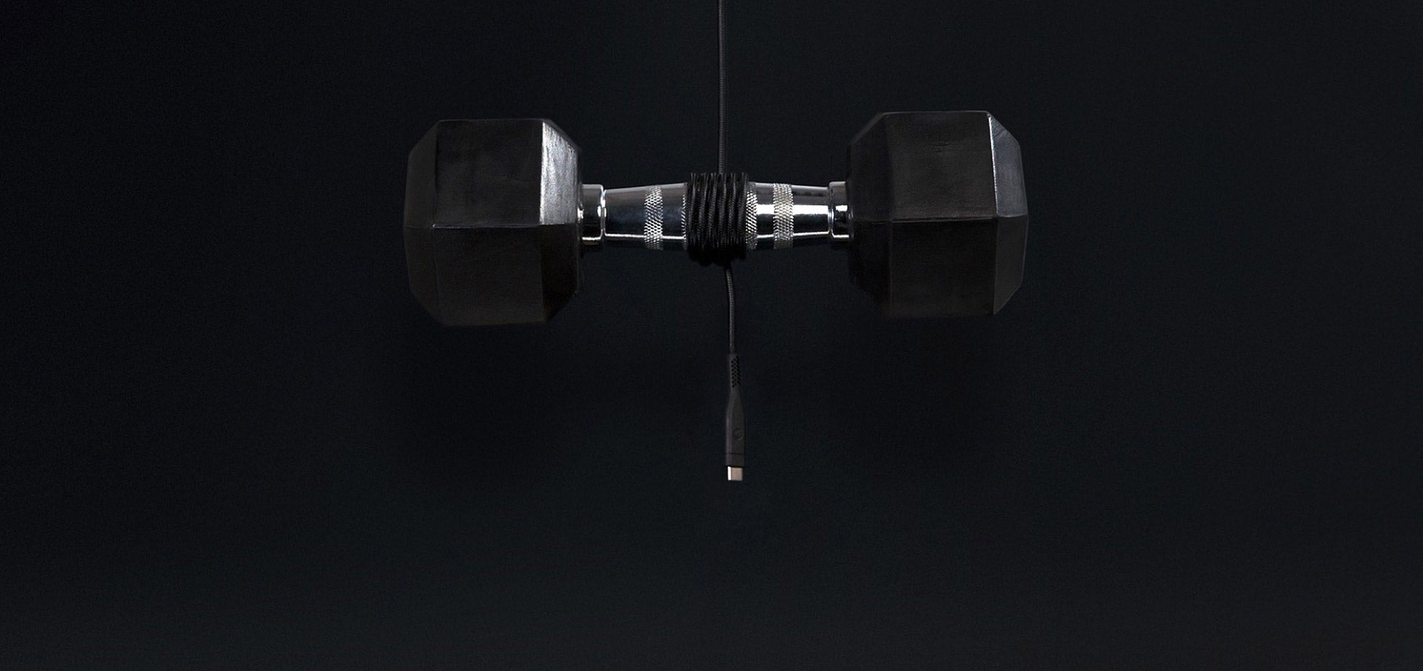 A cable wrapped around a dumbbell to show the strength of the cable