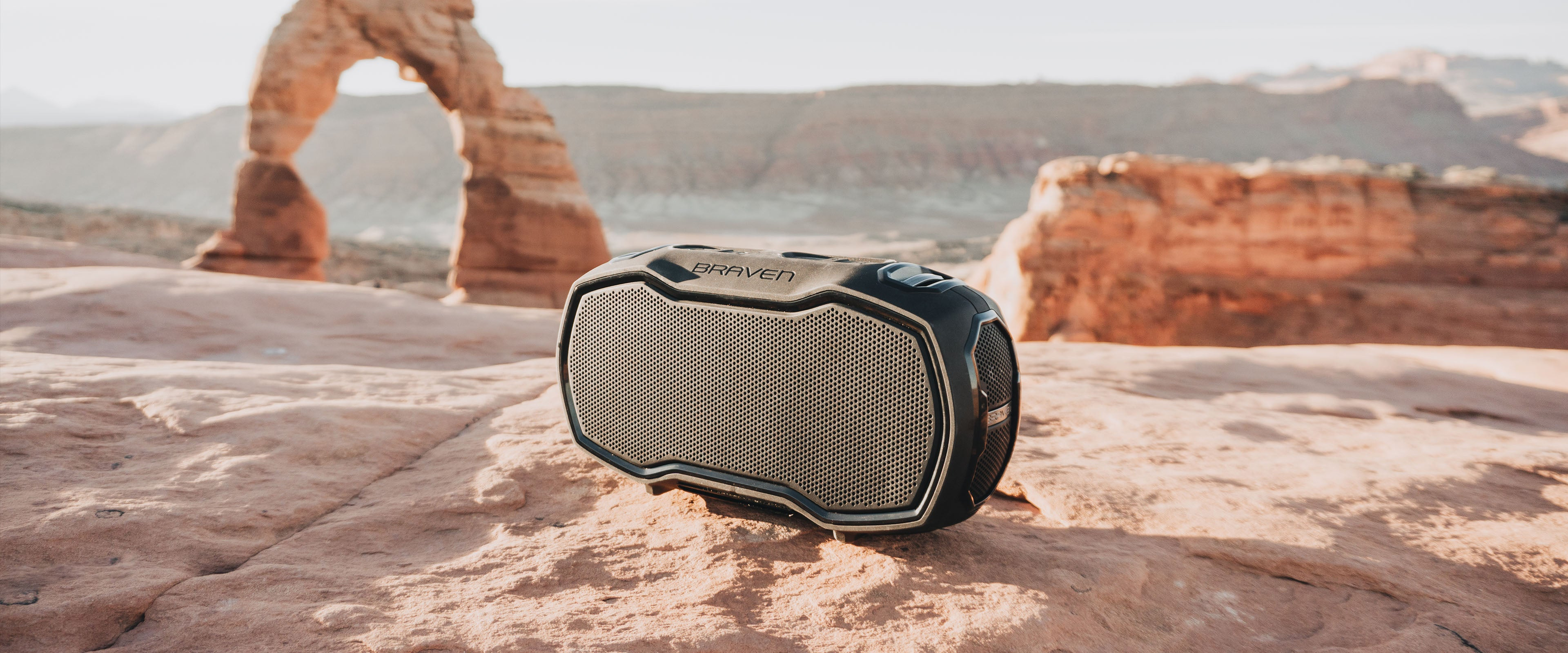 A speaker on a rock by Delicate Arch in Arches National Park