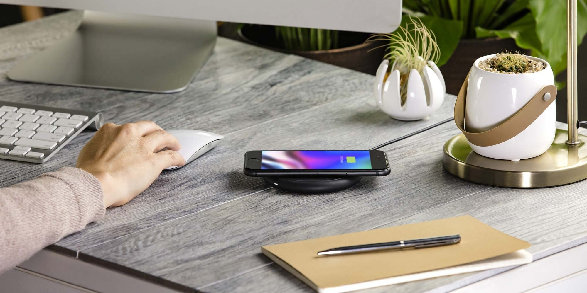 An iPhone wirelessly charging on a mophie charging pad