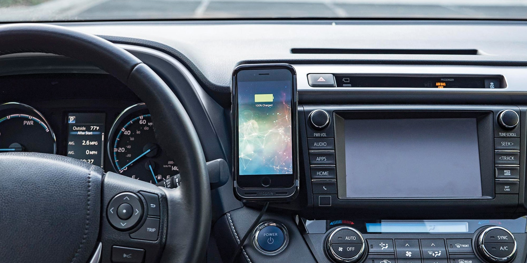 A phone in a car with a juice pack flex