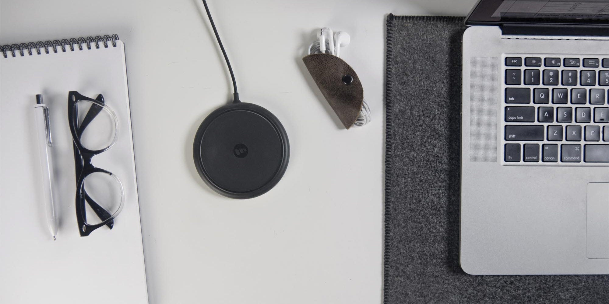 A mophie wireless charging pad on a desk