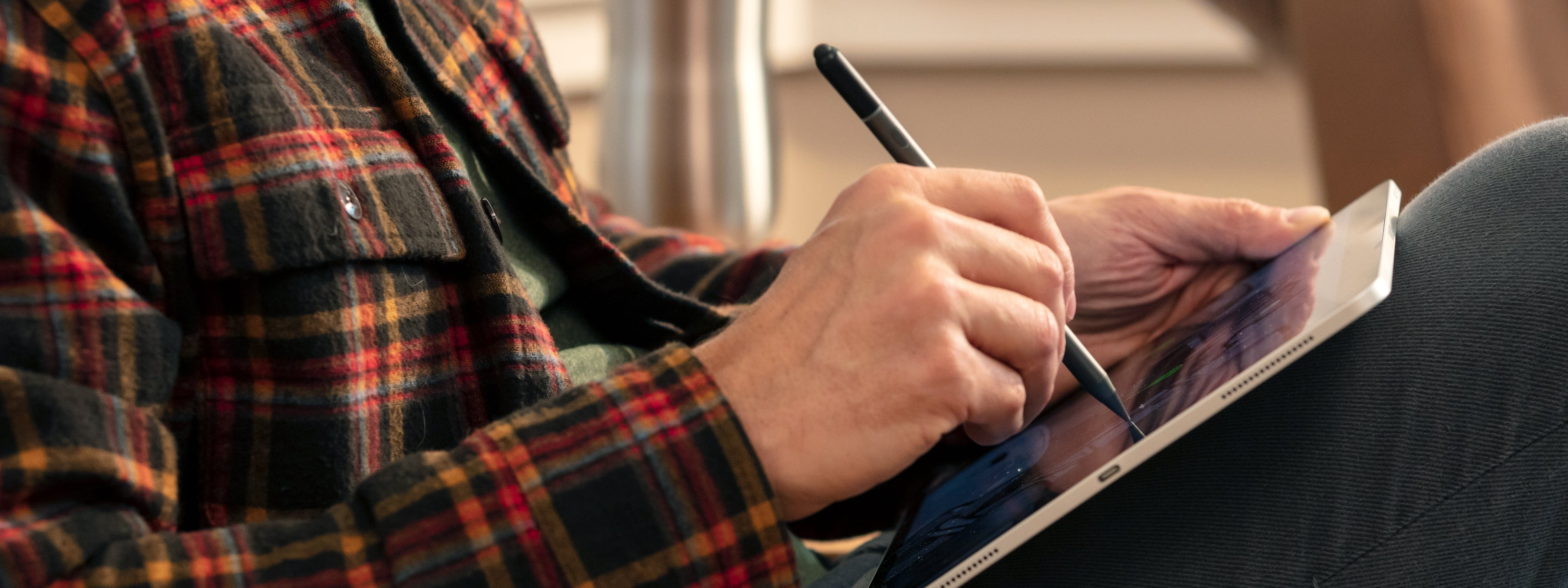 man using stylus on iPad
