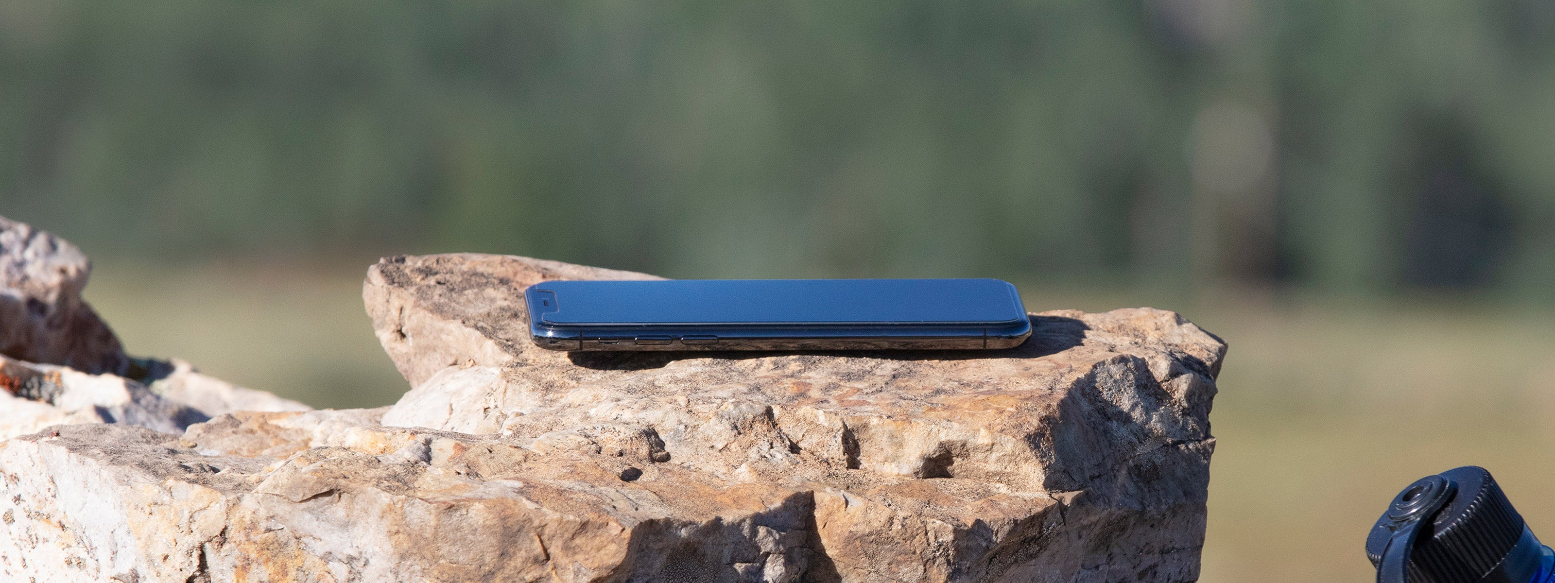 iPhone 11 laying on rock