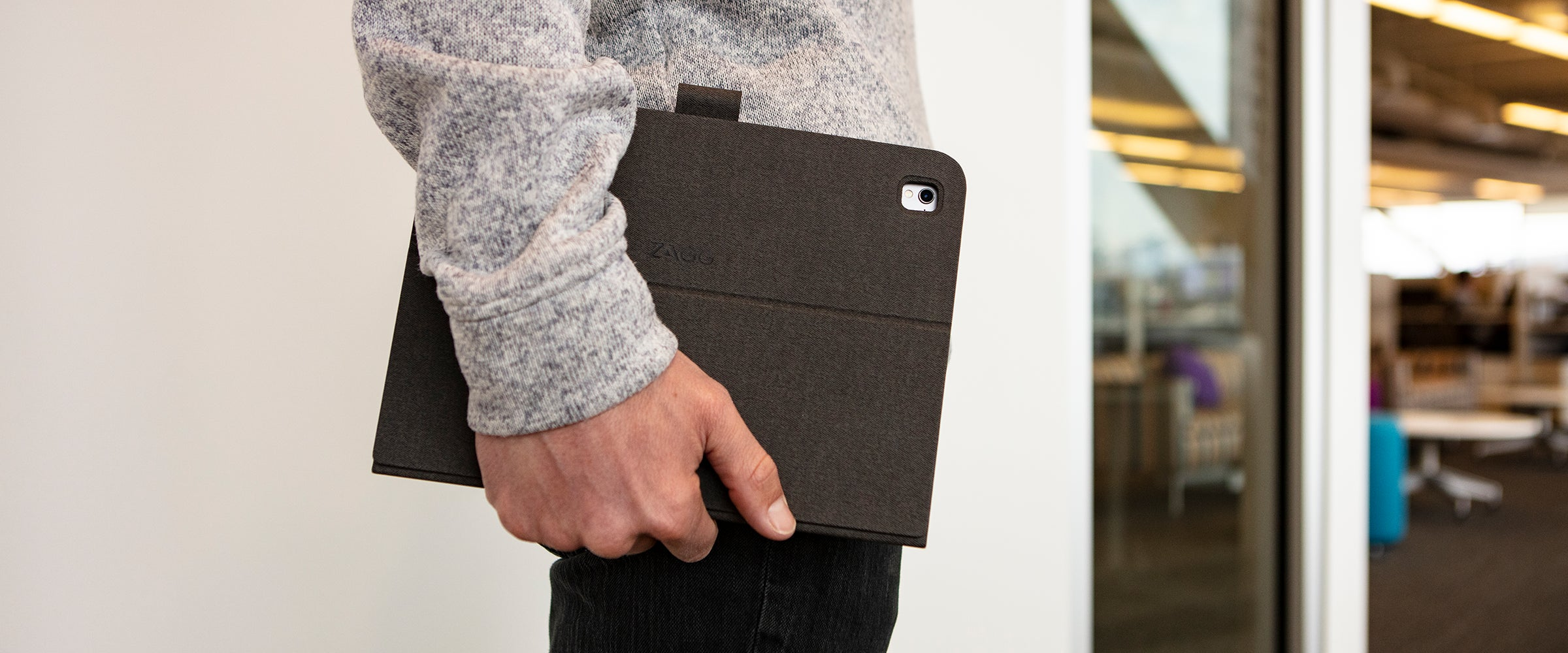 Man holding an iPad with a Messenger Folio case on it