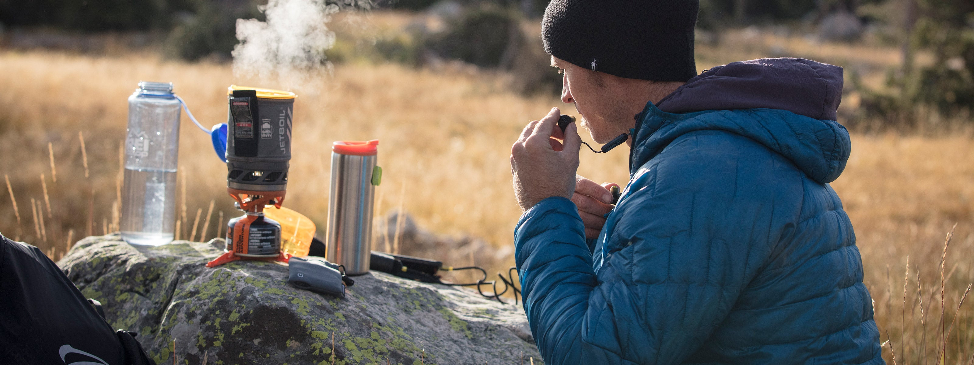Man camping and listening to earbuds
