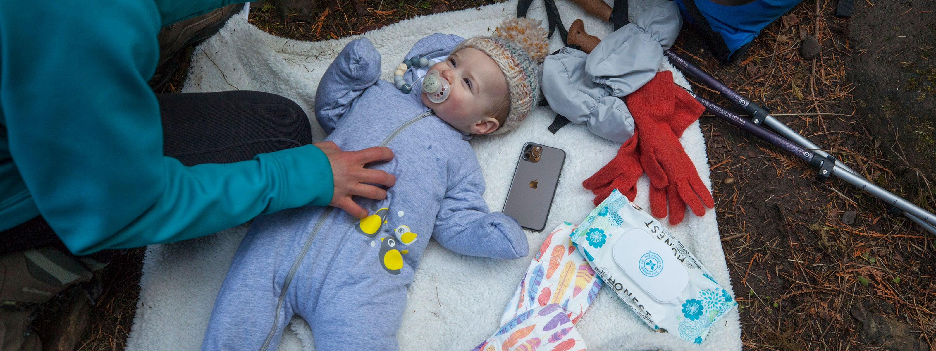 baby lying with iphone
