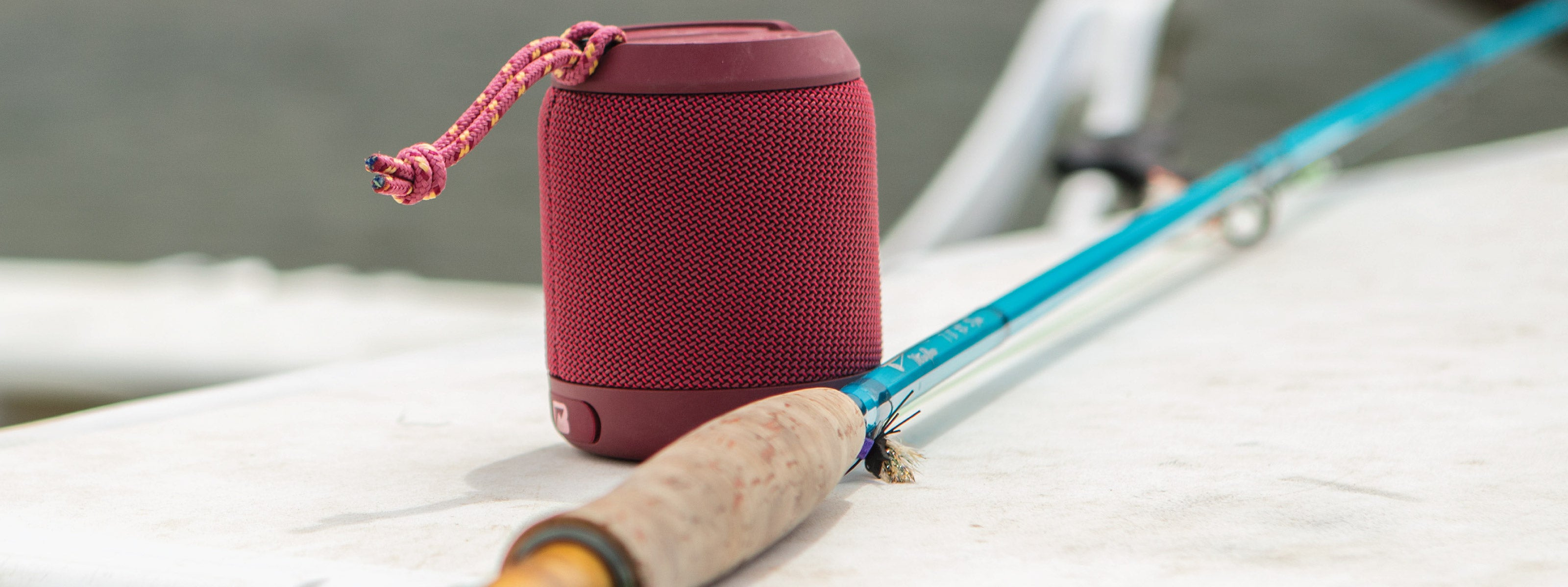 Red speaker with fishing pole
