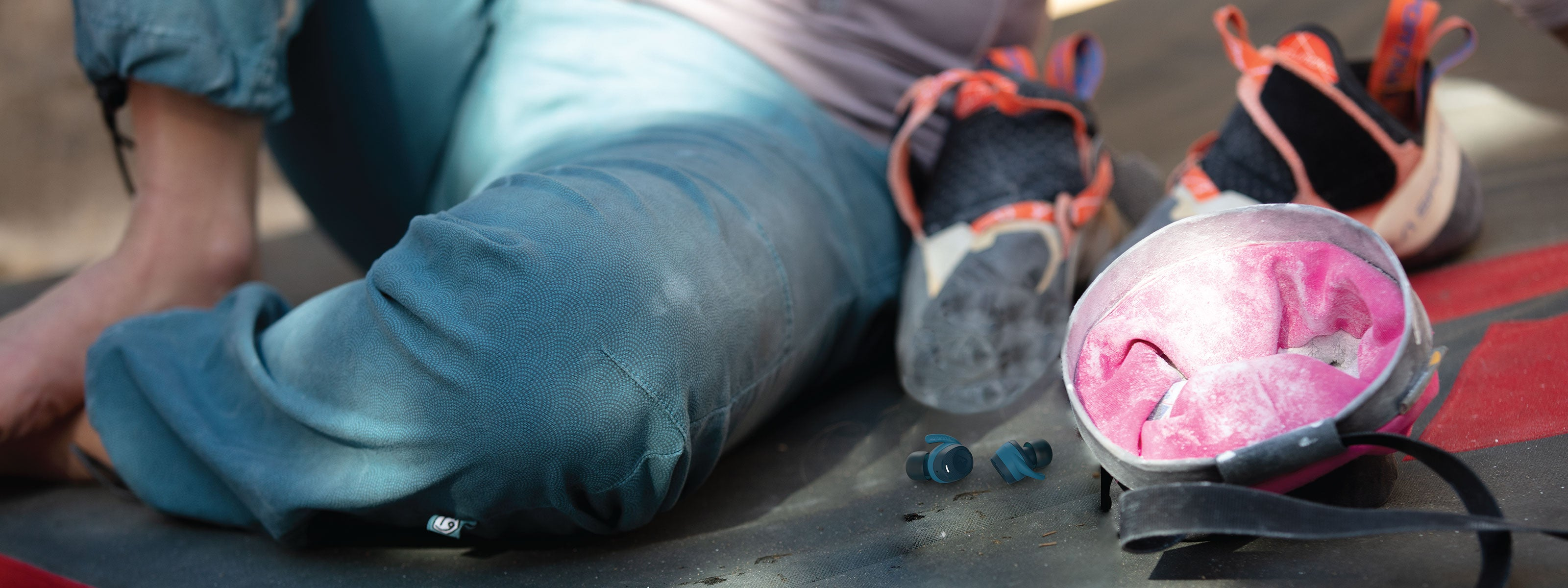 Woman about to rock climb with chalk bag