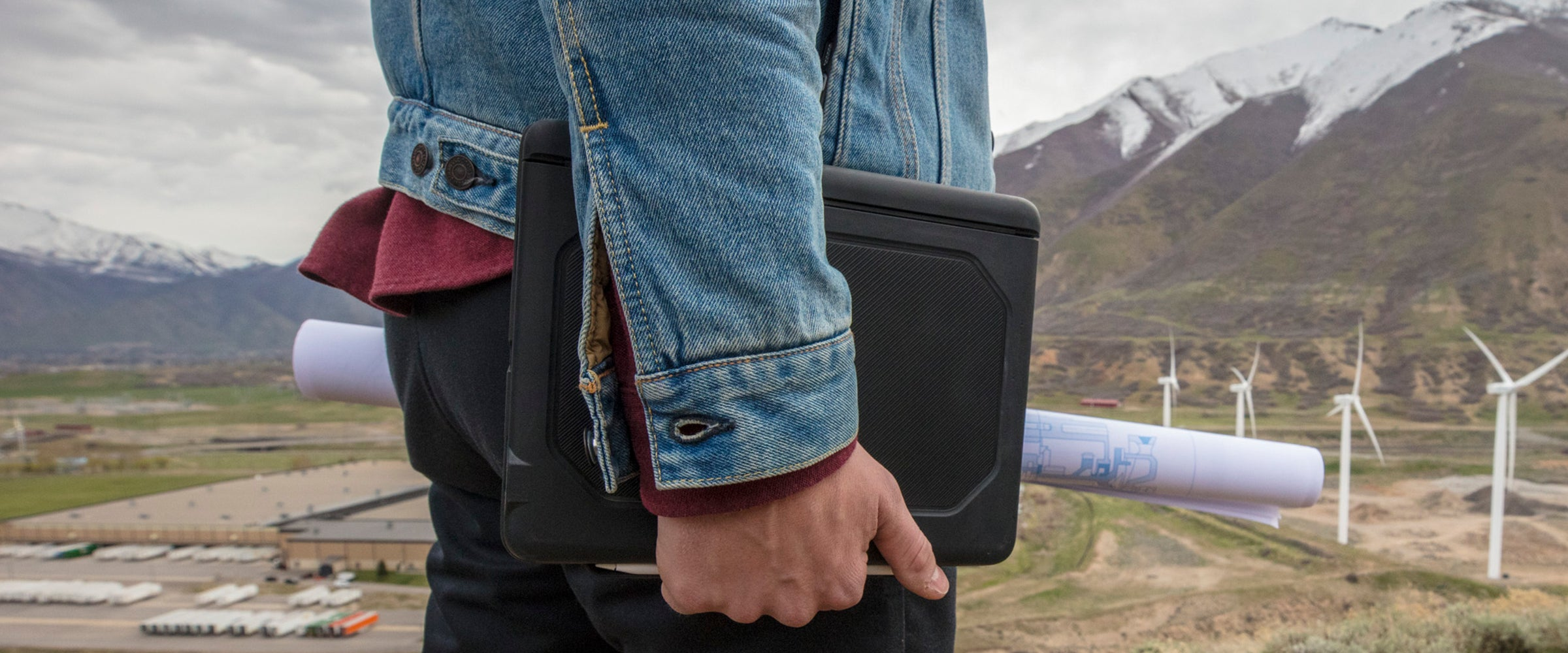 Man holding an iPad with a Rugged Book case