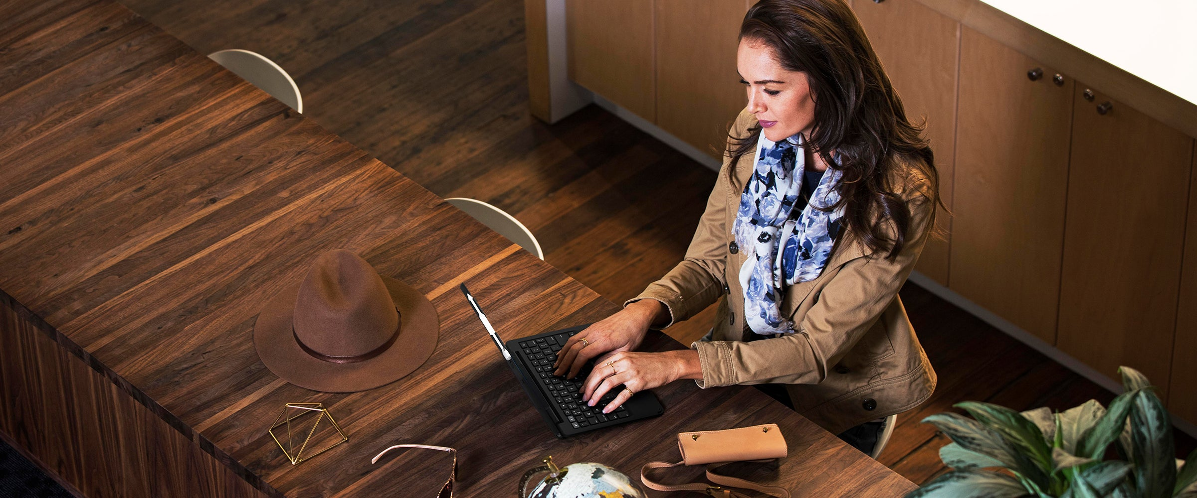 a Woman using an iPad with a ZAGG slim book case and keyboard on it.