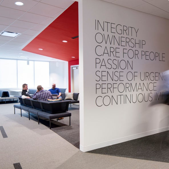 A wall with writing on it at ZAGG Headquarters