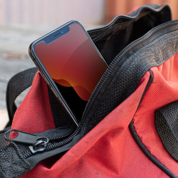Phone peeking out of a backpack