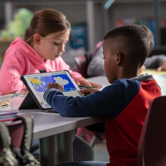 Children using iPads with ZAGG cases on them in a classroom