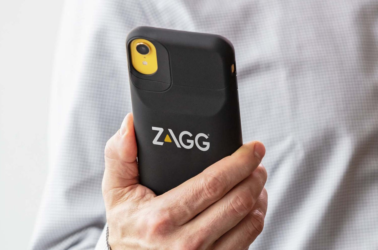 Someone holding a phone with a custom ZAGG case