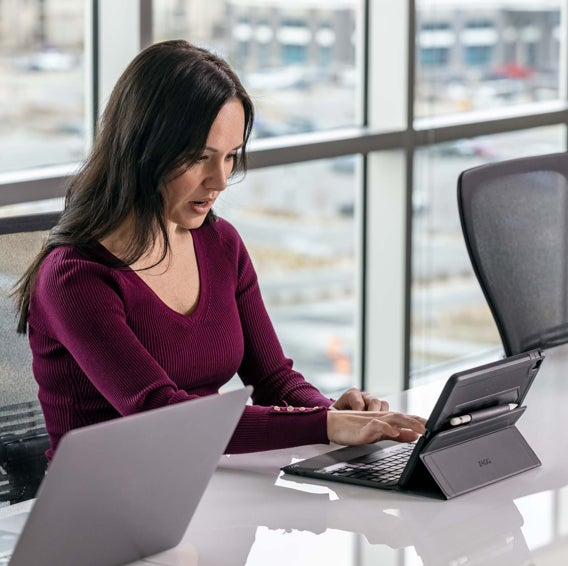 Woman using an iPad with a ZAGG case and keyboard