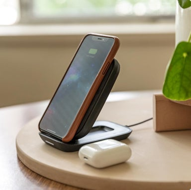 An iPhone charging on a mophie wireless charging base