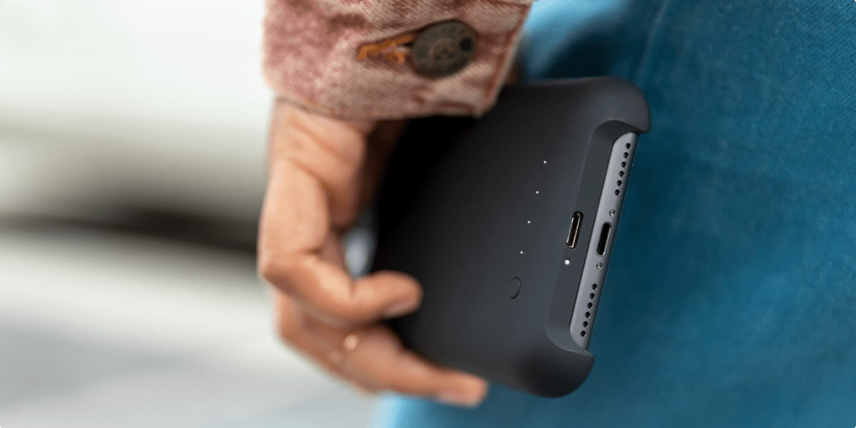 Mobile phone on a charging pad with headphones inserted in the lightning port